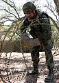 US Navy 070814-N-8547M-017 Yeoman 3rd Class Myles D. Fry, of Naval Mobile Construction Battalion (NMCB) 5 Communications Platoon, binds triple strand concertina wire during Operation Bearing Duel 6-07.jpg