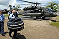 US Navy 070823-N-8704K-007 Musician 1st Class Joe Muzika, attached to Military Sealift Command hospital ship USNS Comfort (T-AH 20), carries his tuba after debarking an Army UH-60 Blackhawk from Joint Task Force Bravo.jpg