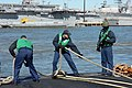 US Navy 080214-N-7668G-068 Crew members aboard the Los Angeles class attack submarine USS Augusta (SSN 710) tend the mooring lines as the ship arrives at Naval Station Norfolk.jpg