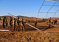 US Navy 080620-N-4973M-010 Amphibious Construction Battalion (ACB) 1 Seabees erect a tension fabric structure to be utilized as a galley at Camp Peguero.jpg