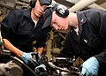 US Navy 080725-N-6764G-089 Engineman Fireman Ryan Wright, left, and Engineman 2nd Class Tim Hall fasten a connector on a main engine lube oil purifier aboard the amphibious transport dock ship USS San Antonio (LPD 17).jpg