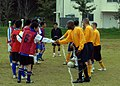 US Navy 081107-N-3215T-004 Sailors assigned to the Arleigh Burke-class guided-missile destroyer USS Curtis Wilbur (DDG 54) and airmen from the Japan Self Defense Force Western Air Force shake hands before playing a soccer match.jpg