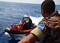 US Navy 090901-G-6414E-003 Cape Verde Coast Guard Master Chief Victor Delgado watches the approach of a small boat from the U.S. Coast Guard cutter Legare (WMEC 912).jpg
