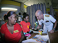 US Navy 091007-N-6220J-016 Rear Adm. Bill Goodwin, Assistant Chief of Naval Operations for the Next Generation Enterprise Network, shares a moment with a young patient at the Shriners Hospital for Children in Greenville during.jpg