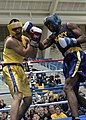 US Navy 100226-N-3066M-006 Midshipman 1st Class Josh Fernandez, right, lands a punch on Midshipman 2nd Class Luke Culver during the 69th Annual U.S. Naval Academy Brigade Boxing Championships.jpg