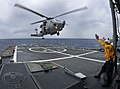 US Navy 100304-N-4774B-083 An SH-60F Sea Hawk helicopter assigned to the Red Lions of Helicopter Anti-submarine Squadron (HS-15) lands aboard the guided-missile cruiser USS Bunker Hill (CG 52).jpg