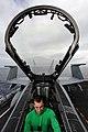 US Navy 100914-N-5386R-019 Aviation Electronics Technician 3rd Class Eric S. Hawkins performs system checks on an F-A-18 Hornet aboard USS Abraham.jpg