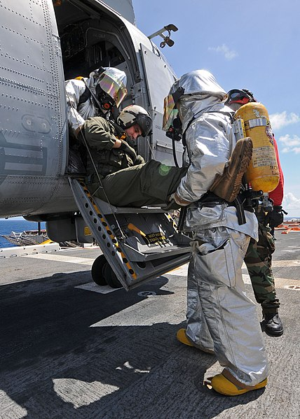 File:US Navy 101016-N-3237D-090 A crash and salvage team removes an injured Sailor from a helicopter during a mass casualty drill aboard the multi-purpo.jpg