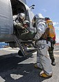US Navy 101016-N-3237D-090 A crash and salvage team removes an injured Sailor from a helicopter during a mass casualty drill aboard the multi-purpo.jpg