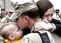US Navy 110216-N-6272M-023 Builder 2nd Class Sean Duvall is welcomed home by his wife and son at the Naval Construction Battalion Center Training H.jpg
