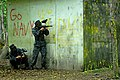 US Navy 110517-N-OA833-009 Plebes take cover during a paintball competition during Sea Trials, the capstone training exercise for Naval Academy fre.jpg