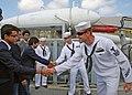 US Navy 110919-N-VP123-017 Mineman 1st Class Ben Hall and Mineman 3rd Class Zach Abel greet high school students from Chittagong Grammar School dur.jpg