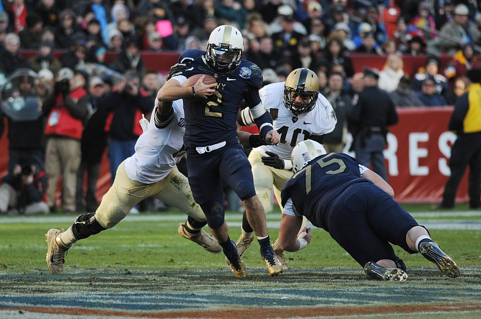 US Navy 111210-N-OA833-895 U.S. Naval Academy quarterback (^2) Kriss Proctor runs the ball during the 112th Army-Navy Football game