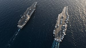 US Navy 120119-N-OY799-094 The Nimitz-class aircraft carriers USS John C. Stennis (CVN 74) and USS Abraham Lincoln (CVN 72) transit during a turnov.jpg