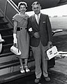 United Airlines, Hawaii handbag in the 1960s, from- An unidentified couple stand on the steps to an aircraft (13244363504) (cropped).jpg