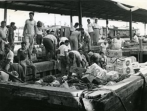 Economy of Samoa - Unloading a lighter at Apia Wharf, around 1975-1985.