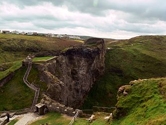 Tintagel Castle - The outer and upper wards of the ruined Tintagel Castle (part of the village of Tintagel may be seen in the distance)