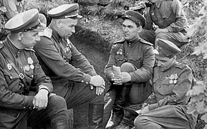 75th Guards Rifle Division - Vlasenko, Gorishny, Colonel A.V. Mukhin, and Lieutenant Colonel and writer Konstantin Simonov at the command post of the 75th Guards Rifle Division near Ponyri during the Battle of Kursk