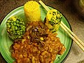 Vegan meal, onion curry, rice, peas, plant based.jpg