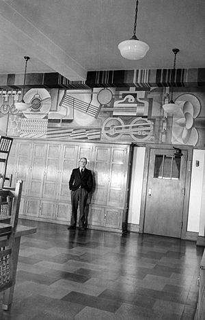 Samuel Gompers High School - Eric Mose with his mural Power (1936)