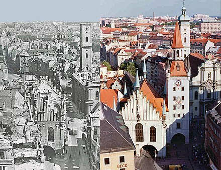 Bombing damage to the Altstadt. Note the roofless and pockmarked Altes Rathaus looking up the Tal. The roofless Heilig-Geist-Kirche is on the right of the photo. Its spire, without the copper top, is behind the church. The Talbruck gate tower is missing completely.