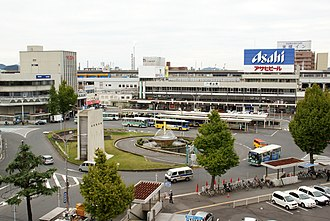 Tokuyama Station - Station building with large sign of Asahi Breweries