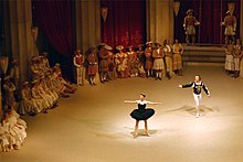 A photograph of a performance of Swan Lake during the third act, with the protagonist transformed into the Black Swan