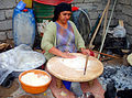 Woman making flat bread in a Kurdish village near the Turkish border.jpg