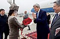 Women in Traditional Kyrgyz Dress Present Roses to Secretary Kerry Following Arrival in Bishkek on Central Asian Tour (22010957083).jpg
