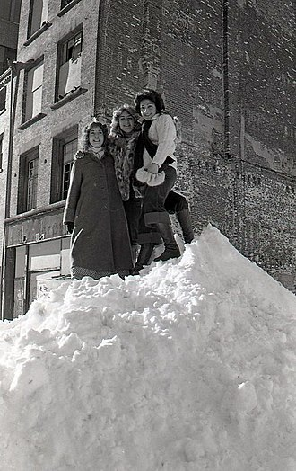 Snowdrift - Women standing atop a large snowdrift from the Northeastern United States blizzard of 1978
