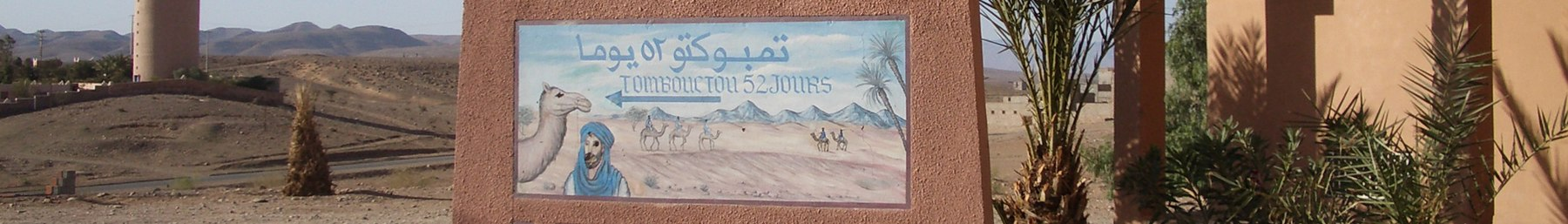 A sign in Zagora: Timbuktu is 52 days away by camel