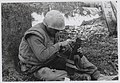 1.5 Marine cleans his M-16 during the Battle of Hue.jpg