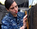 110702-N-MJ491-131 - Airman Analia Ovalle troubleshoots a general-purpose interface console aboard the aircraft carrier USS Ronald Reagan CVN 76 in the Arabian Sea on.jpg