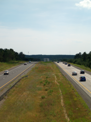 Ontario Highway 115 - Facing southwest along Highway 115; in the distance the median narrows and the route merges with Highway 35