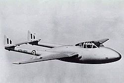 Single-engined military jet with twin tailbooms in flight