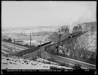 Central Massachusetts Railroad - An eastbound passenger train passes over Clinton Viaduct on Dec. 11, 1903 during work on the Wachusett Dam.
