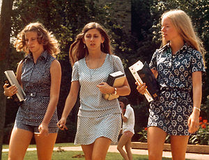 Freshman college girls between classes. By sta...