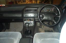 1992 Nissan Cefiro black dashboard from interior.jpg