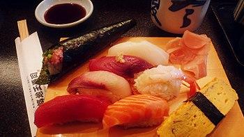 Many types of sushi ready to eat.