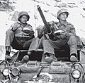 2 members of the Brazilian Expeditionary Force lunching on top of their M8 Greyhound.jpg