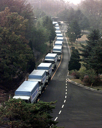 South Korean aid convoy entering North Korea through the Demilitarized Zone, 1998 501 cows sent to North Korea.jpg