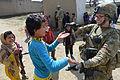 755th ESFS airman with school children near Bagram.jpg