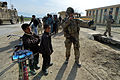 755th ESFS member interacting with Afghan children.JPG