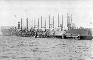USS Nereus AC-10  loading coal at Nagasaki, Japan in April 1916.