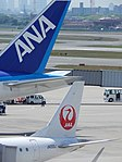 ANA 777 and JAL Embraer tails (15937660130).jpg