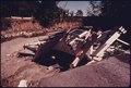 A COVERED BRIDGE LIES IN FURNACE RUN AT OAK HILL AND EVERETT ROADS IN BOSTON TOWNSHIP, NEAR CLEVELAND, OHIO. A... - NARA - 557993.tif