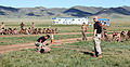 A Mongolian service member participates in a practice run for a pepper spray qualification course during Non-Lethal Weapons Executive Seminar (NOLES) 13 at Five Hills Training Area, Mongolia, Aug. 21, 2013 130821-M-DR618-002.jpg