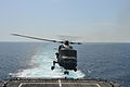 A Royal Malaysian Navy Super Lynx helicopter lands on the flight deck of the littoral combat ship USS Freedom (LCS 1) in the South China Sea during landing qualifications June 18, 2013, as part of Cooperation 130618-N-PD773-089.jpg
