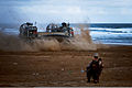 A U.S. Marine provides security while a landing craft, air cushion drops Marines on a beach in Cap Draa, Morocco, for a quick strike, indirect fire mission on a simulated enemy fuel convoy April 9, 2012, during 120409-M-IX060-022.jpg