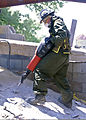 A U.S. Marine with the Chemical Biological Incident Response Force (CBIRF) uses a motorized jackhammer to break through a slab of concrete during a search and extraction operation as part of exercise Vibrant 120729-A-AC168-004.jpg